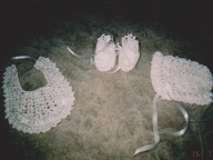 Crochet bonnet, bib and booties set