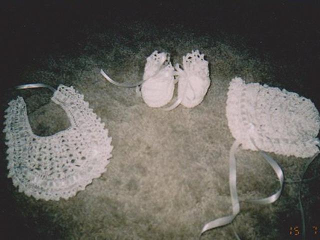 Crochet bonnet, bib and booties set