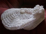 Silk crochet beret with 3 flowers attached