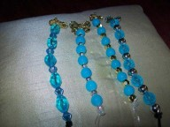 Blue beads with gold silver brooches