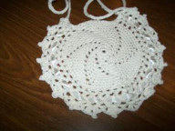 Round crochet cotton bib with lacy edge