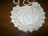 Round crochet cotton bib with lacy edge