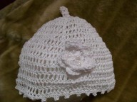 Crochet silk cap with stalk and flower n beads. In silk or cotton.